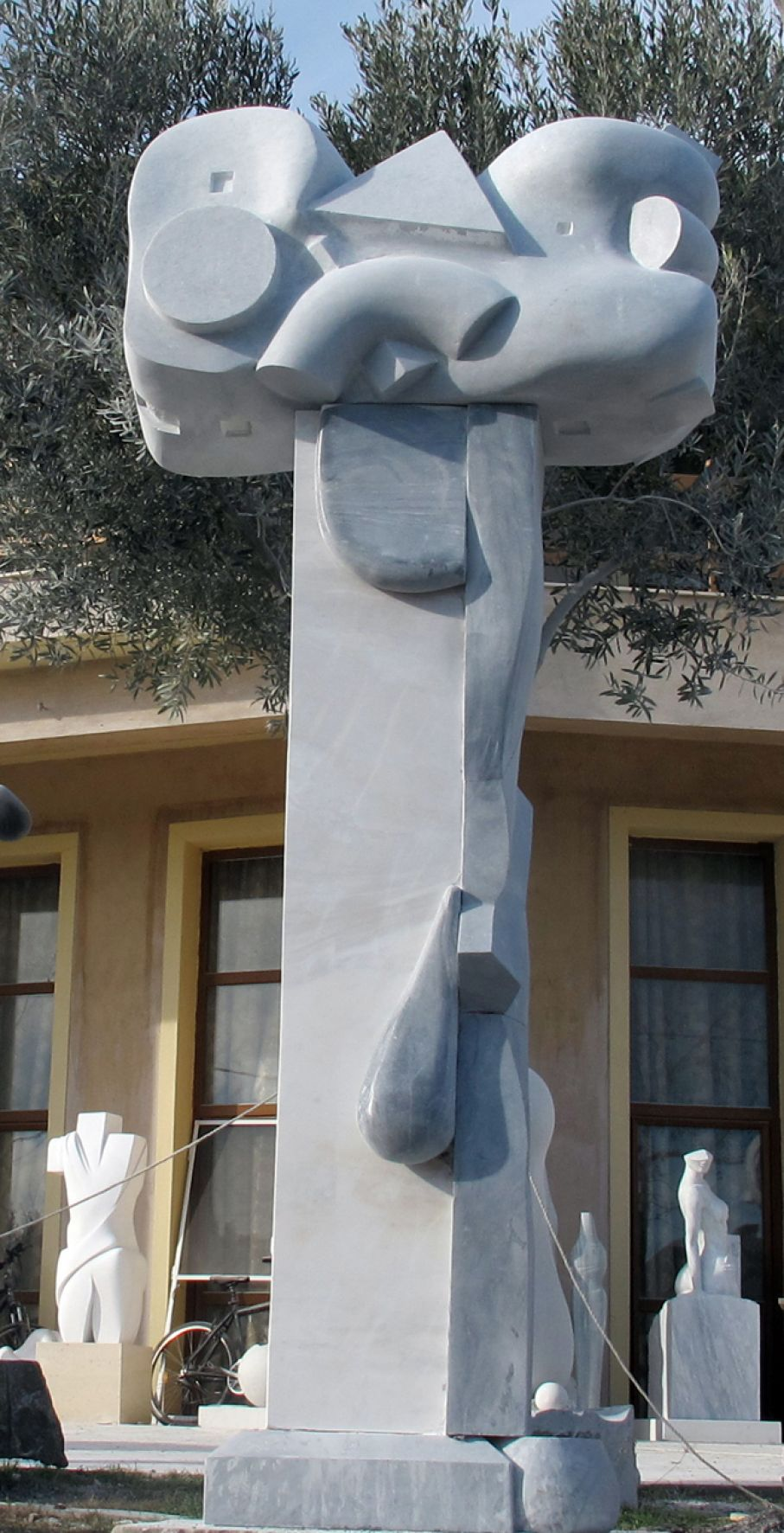 BRIEF DESCRIPTION. Original marble sculpture of  Giorgie Cpajak, completed within Myrό Antiques House premises, in Souroti, Thessaloniki, GREECE, as part of the Greek Marble Initiative. Dimensions: 310 X 140 X 60 cm (with the depicted base).