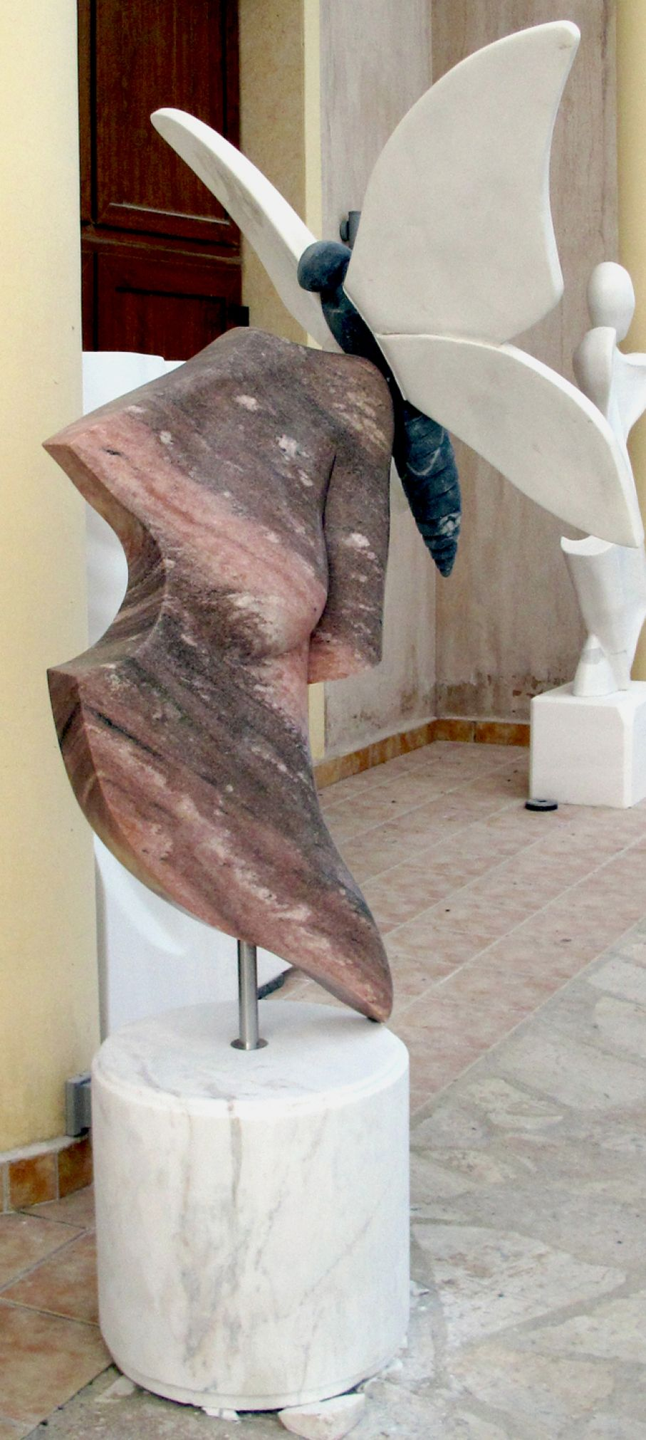 "Original marble sculpture of  John Bizas, created within Myrό Antiques House premises, in Souroti, Thessaloniki, GREECE, as part of the Greek Marble Initiative, bearing the title ""Farfalla"". Dimensions: 200 X 90 X 105 cm (with its base)."
