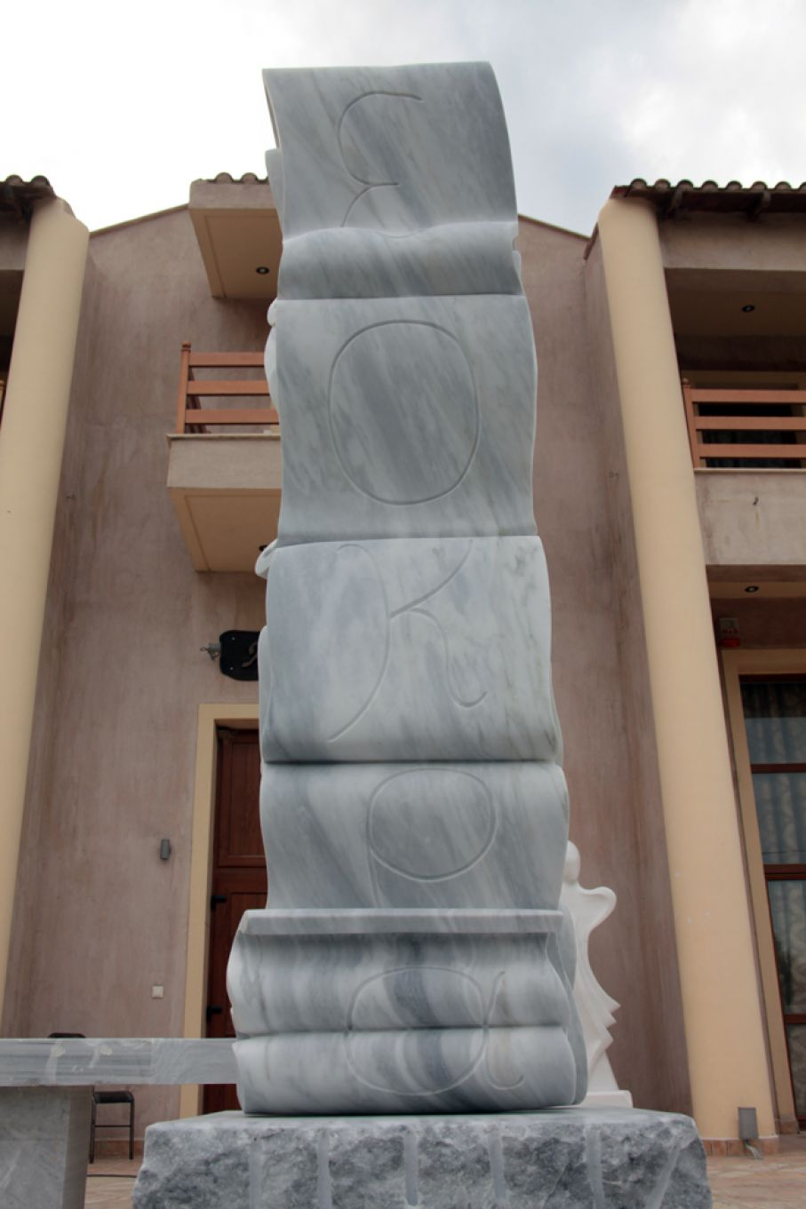 "Original marble sculpture of Michael Vouzounerakis, completed on August 2013, within Myrό Antiques House premises, in Souroti, Thessaloniki, GREECE, as part of the Greek Marble Initiative, bearing the title ""Riddle"". Dimensions: 280 X 80 X 70 cm (without its base)."