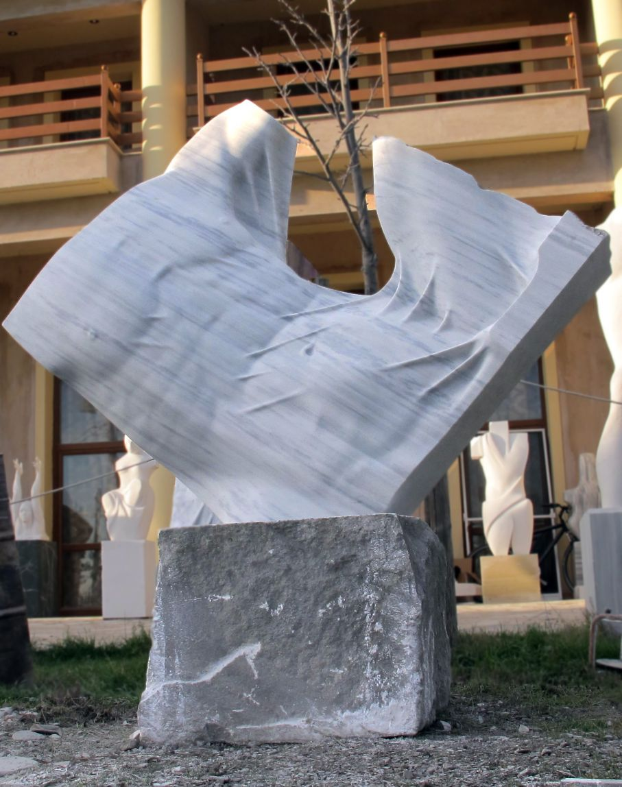 Original marble sculpture of  Kamen Tanev, completed within Myrό Antiques House premises, in Souroti, Thessaloniki, GREECE, as part of the Greek Marble Initiative. Dimensions: 192 X 170 X 62 cm.