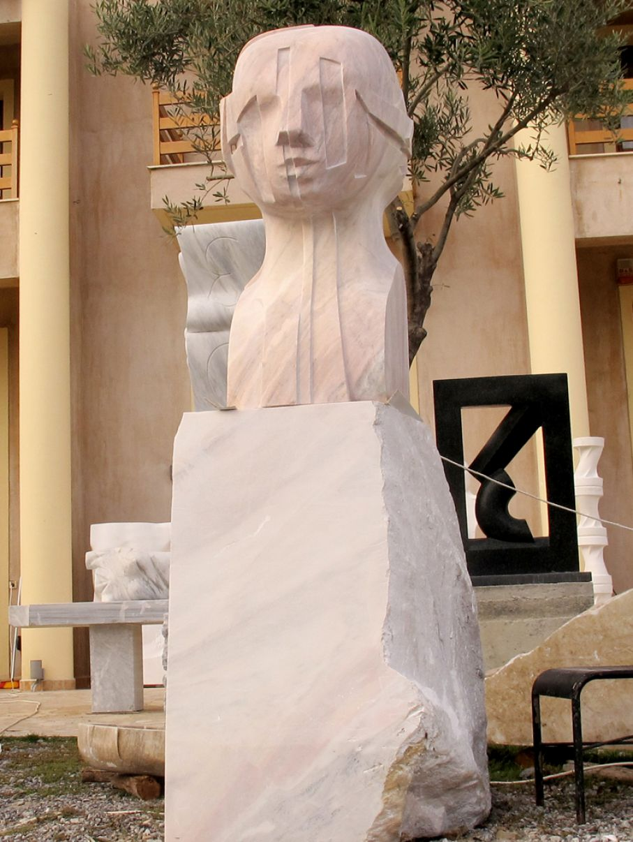 Original marble sculpture of  Giorgie Cpajak, completed on September 2014, within Myrό Antiques House premises, in Souroti, Thessaloniki, GREECE, as part of the Greek Marble Initiative.  Dimensions: 260 X 60 X 66 cm (with the depicted base).