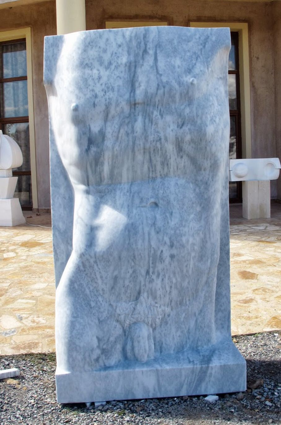 "Original marble sculpture of Kamen Tanev, completed in 2013, within Myrό Antiques House premises, in Souroti, Thessaloniki, GREECE, as part of the Greek Marble Initiative, bearing the title ""Torso"". Dimensions: 210 X 120 X 60 cm (without a base)."