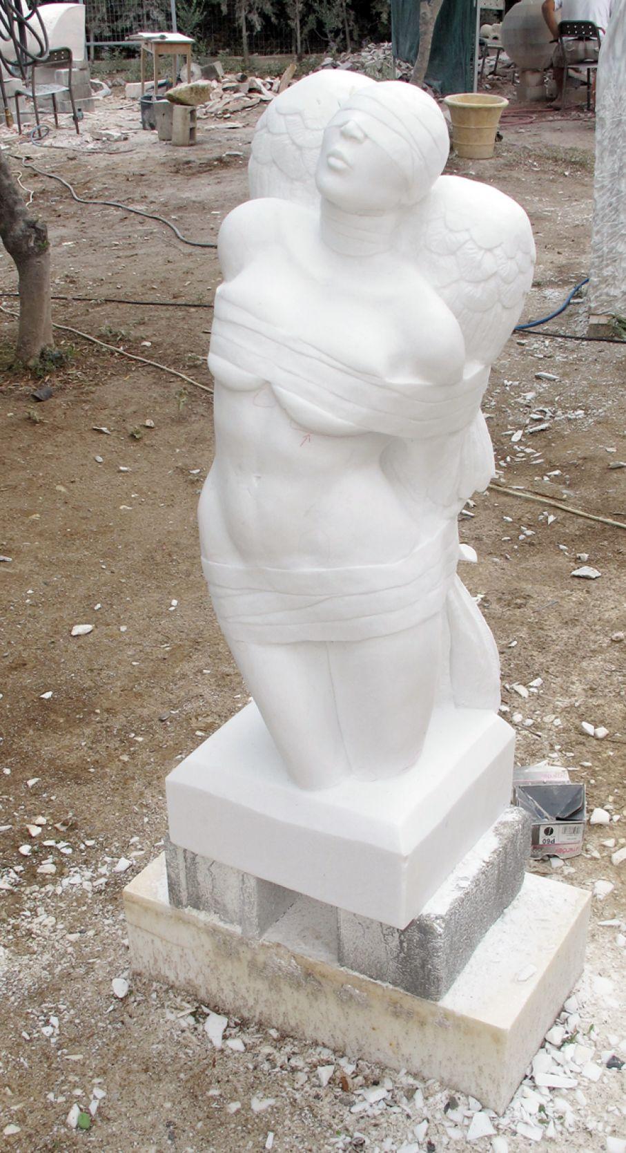 "Original marble sculpture of Sherry Tipton, completed on July 2014, within Myrό Antiques House premises, in Souroti, Thessaloniki, GREECE, as part of the Greek Marble Initiative, bearing the title ""Bound Angel III"". Dimensions: 108 X 40 X 36 (depicted with a pedestral, but needs a base)."