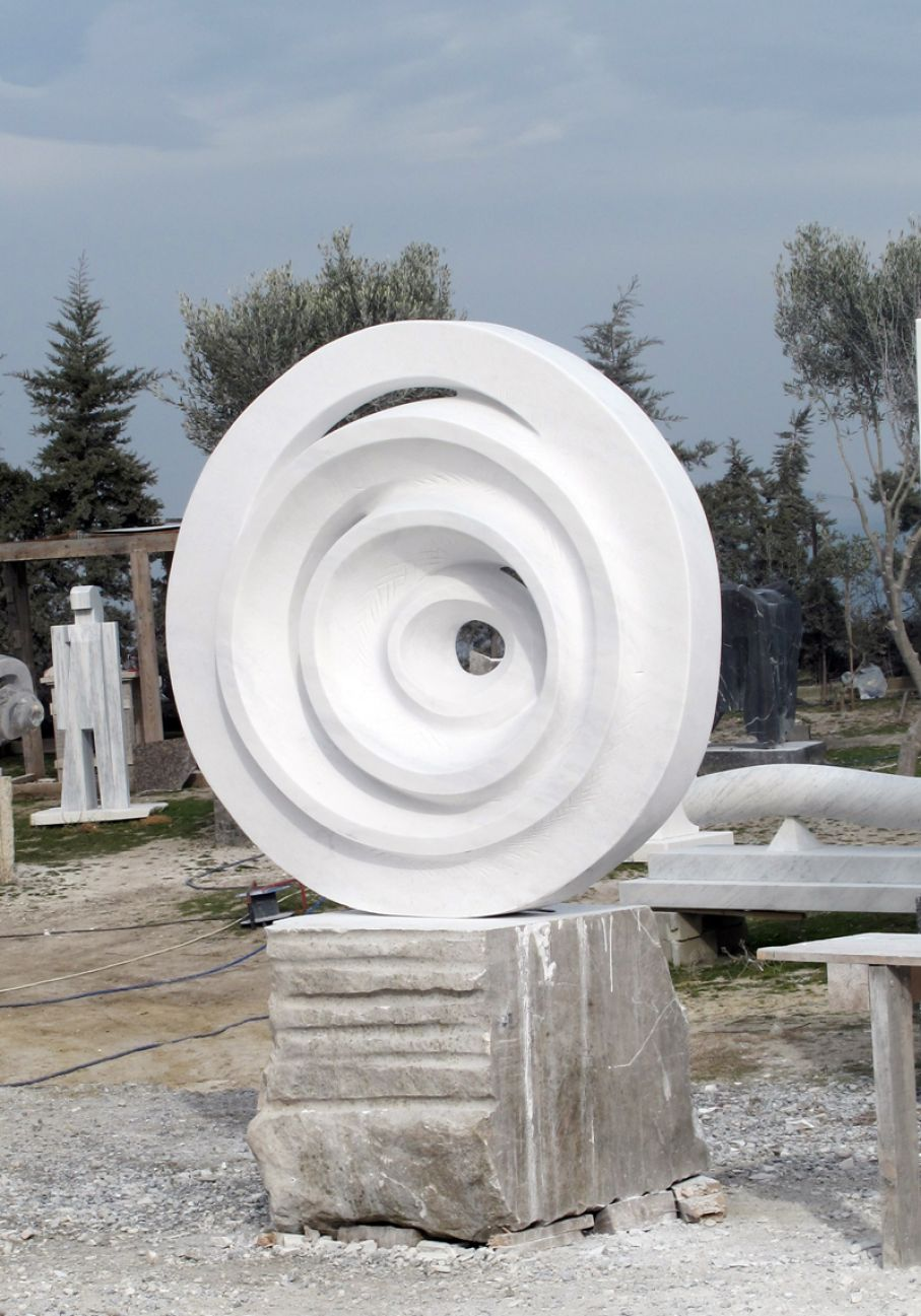 "BRIEF DESCRIPTION. Original marble sculpture of  Odysseas Tosounidis, within Myrό Antiques House premises, in Souroti, Thessaloniki, GREECE, as part of the Greek Marble Initiative, bearing the title ""Uterus"". Dimensions: 211 X 160 X 85 cm."