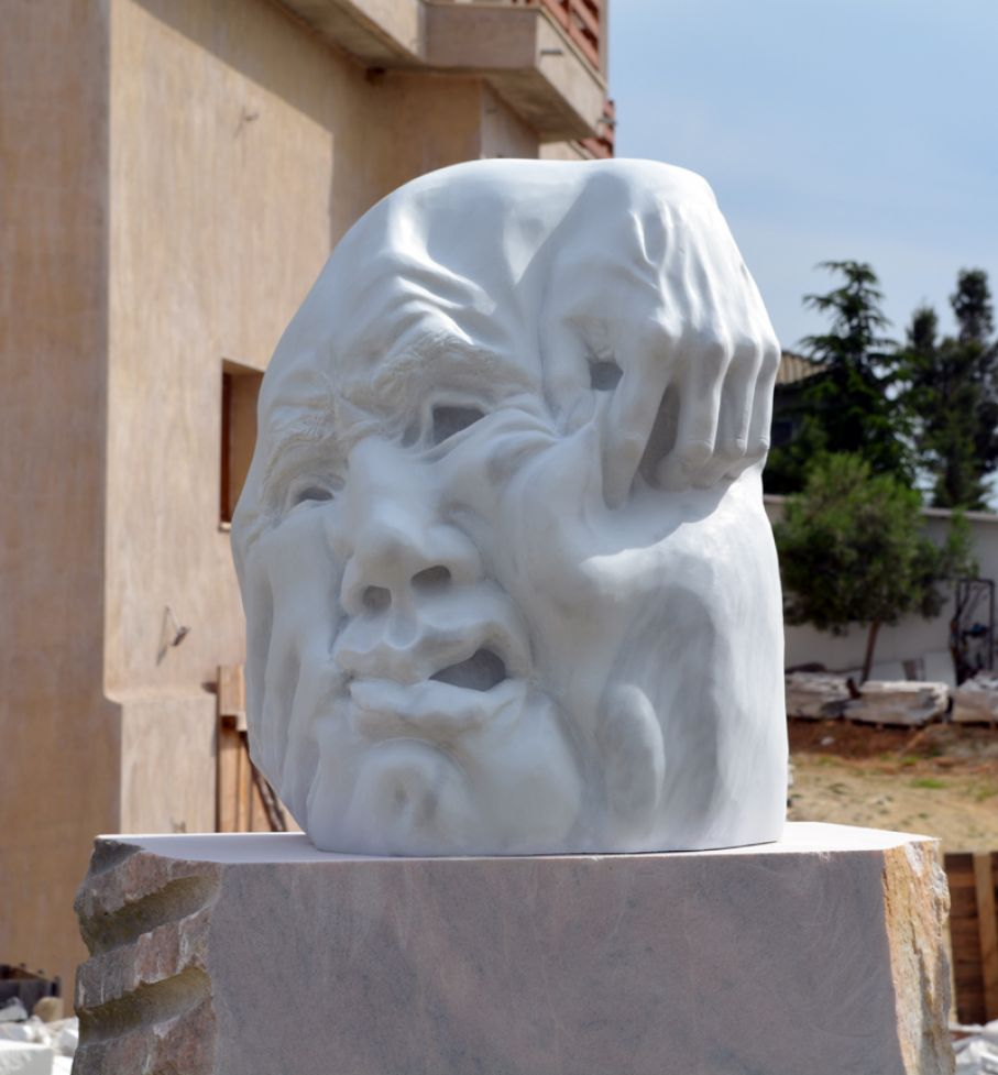 BRIEF DESCRIPTION. Original marble sculpture of  Tzeni Skalkou, completed on January 2015, within Myrό Antiques House premises, in Souroti, Thessaloniki, GREECE, as part of the Greek Marble Initiative.  Dimensions: 67 X 46 X 35 cm (without the depicted base).