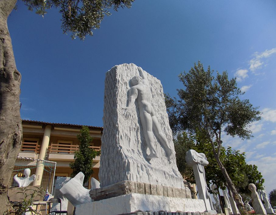 BRIEF DESCRIPTION. Original marble sculpture of Edward Fleming, completed on August 2015, within Myrό Antiques House premises, in Souroti, Thessaloniki, GREECE, as part of the Greek Marble Initiative. Dimensions: 360 X 200 X130 cm.