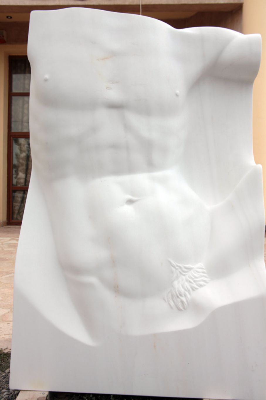 "Original marble sculpture of Kamen Tanev, completed in 2013 within Myrό Antiques House premises, in Souroti, Thessaloniki, GREECE, as part of the Greek Marble Initiative, bearing the title ""Apollo"". Dimensions: 150 X 100 X 41 cm (without a base)."