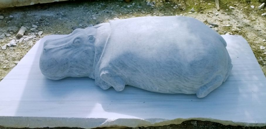 "Original marble  sculpture of  Vitaly Gnatyuk, completed on September 2014, within Myrό Antiques House premises, in Souroti, Thessaloniki, GREECE, as part of the Greek Marble Initiative, bearing the title ""Hippo"".  Dimensions: 36 X 80 X 155 cm (without its base)."