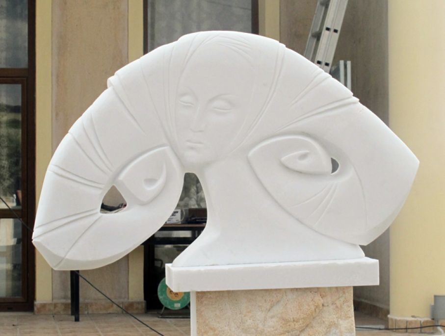 "Original marble sculpture of Vitaly Gnatyuk, completed on August 2013, within Myrό Antiques House premises, in Souroti, Thessaloniki, GREECE, as part of the Greek Marble Initiative, bearing the title ""Woman"". Dimensions: 71 X 100 X 23 cm (without its base)."